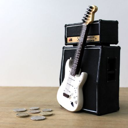 Money Box Amp and White Guitar Strat